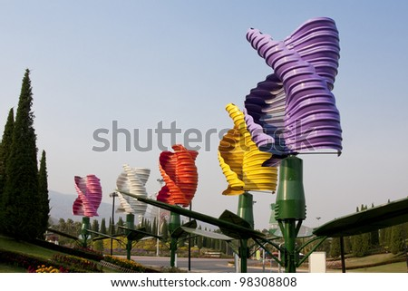 Vertical axis wind turbines in park - stock photo