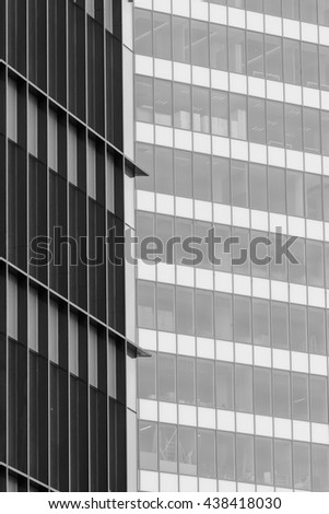 Vertical background with building windows. Close up architecture abstracts from office buildings in downtown. - stock photo