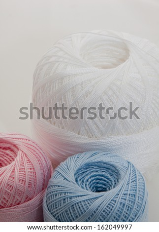vertical blue, white and rose balls for knitting