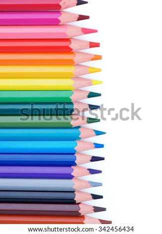 Vertical Border of Multicolored Pencils isolated on white background - stock photo