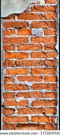 Vertical brick column requires repair - stock photo
