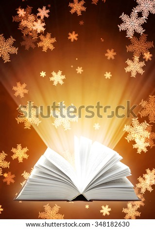 Vertical Christmas background with magic book and snowflakes - stock photo