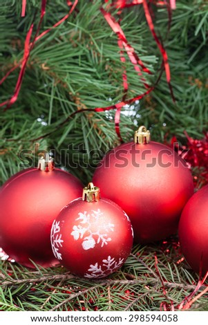 vertical Christmas still life - few red Christmas balls on Xmas tree background - stock photo