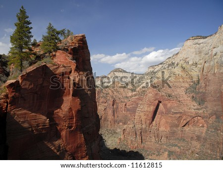Vertical cliffs of Zion Canyon in Utah - stock photo