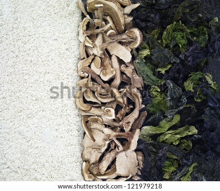 vertical composition of rice, dried mushrooms and dried seaweed