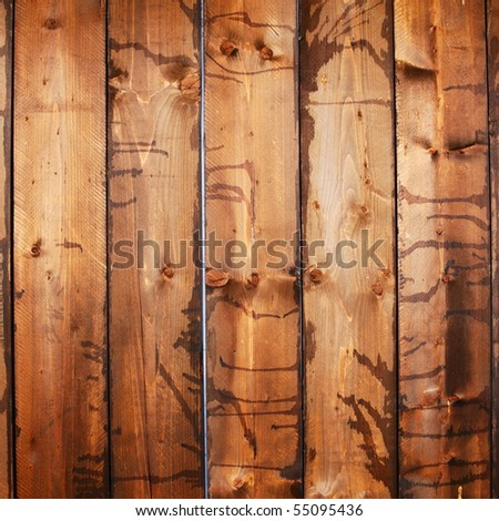 Vertical dark stained wood planks
