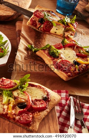 Vertical detailed close up on three slices of delicious vegetable pizza ready to eat