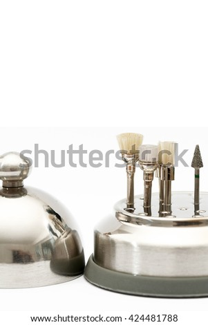 Vertical front view of a bunch of dental cleansing drills standing in a chrome holder - stock photo