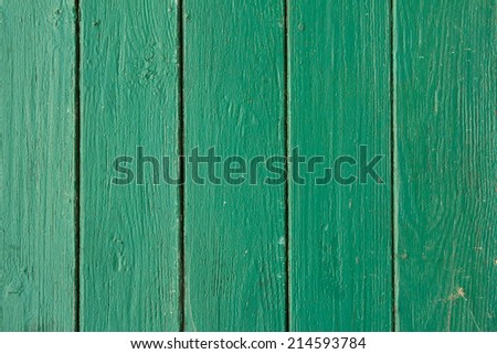 vertical green wooden planks with peeling old paint, texture - stock photo