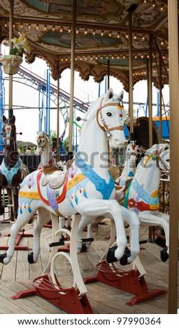 vertical horses in carousel - stock photo
