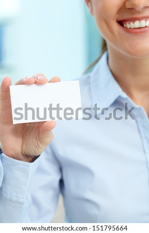 Vertical image of a business woman showing a blank card - stock photo