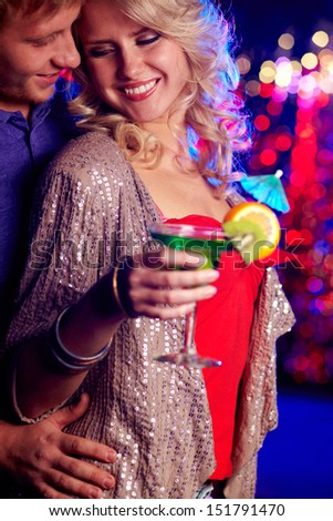 Vertical image of a cheerful beauty hanging out in the club with her boyfriend - stock photo