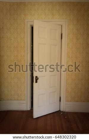 Vertical image of a door slightly open with dark vignetting. & Creak Stock Images Royalty-Free Images \u0026 Vectors   Shutterstock