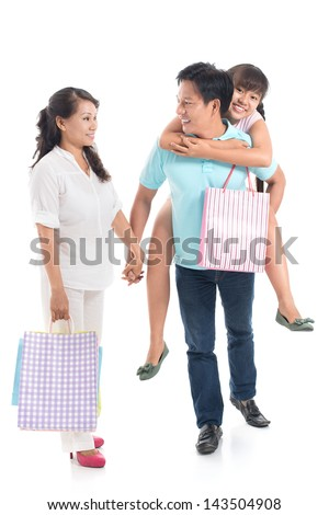 Vertical image of a happy family with shopping-bags against a white background - stock photo