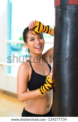 Vertical image of a happy sportswoman after an intense workout - stock photo