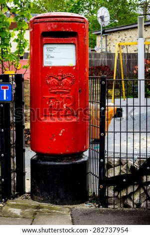 Vertical image of British red letterbox closeup and details - stock photo