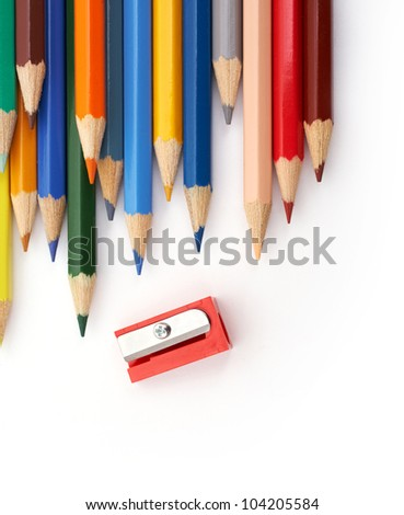 Vertical image of color pencils with a red sharpener - stock photo