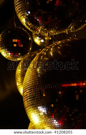 Vertical image of disco balls sparkling in darkness - stock photo