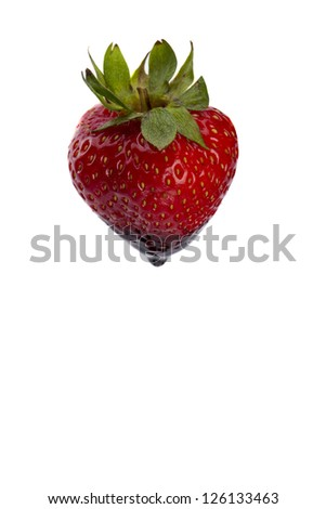 Vertical image of red strawberry with a chocolate drop against the white background
