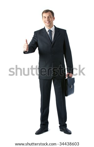 Vertical image of smart employer in suit looking at camera and showing thumb up