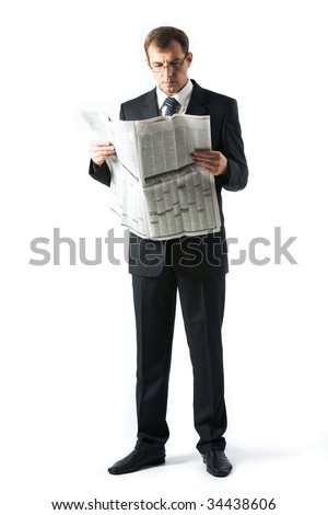 Vertical image of successful boss reading newspaper in studio - stock photo