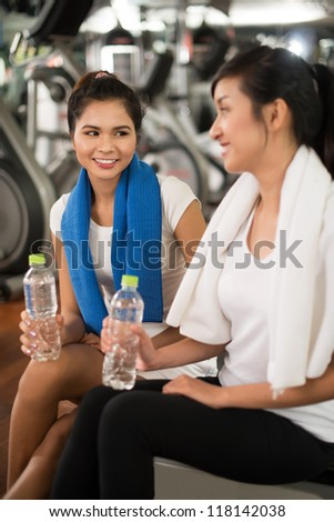 Vertical image of two lovely girls keeping fit - stock photo