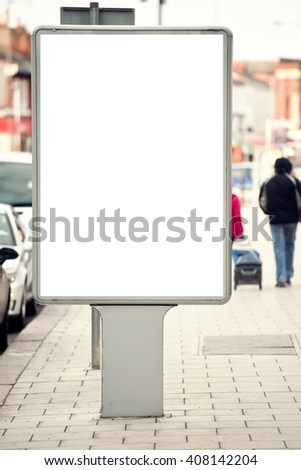 Vertical Isolated blank billboard on the city street - stock photo