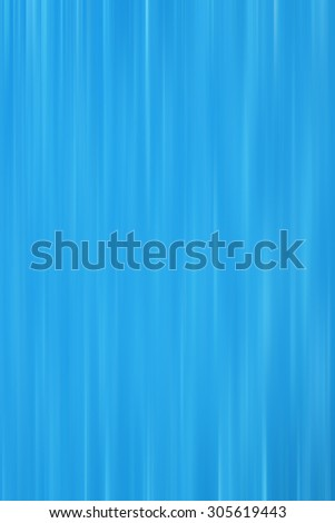 Vertical motion blur on a blue background or wallpaper