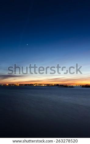 Vertical night landscape of Karlskrona city coast - stock photo