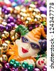 Vertical of Colorful, Plastic Mardi Gras Beads with Court Jester and Space for Copy or Text - stock photo