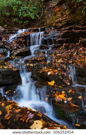 Vertical of Soco Falls in autumn at Smoky Mountains National Park Tennessee and North Carolina