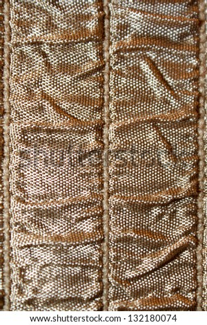 vertical orientation close up of neutral brown colored ruched fabric with lots of copy space / Neutral Ruche - stock photo