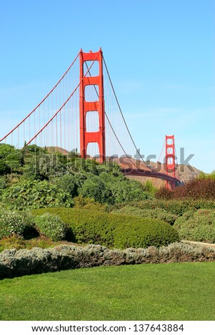 Vertical oriented image of famous Golden Gate Bridge under blue sky in San Francisco, USA. - stock photo