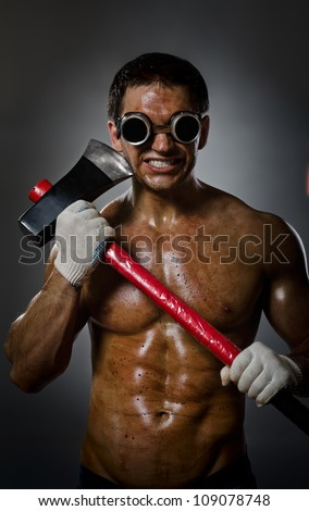 vertical photo crazy frenzied chopper  butcher man  on dark grey background,  action with big axe - stock photo