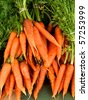 Vertical photo of bunch of carrots at farm market - stock photo
