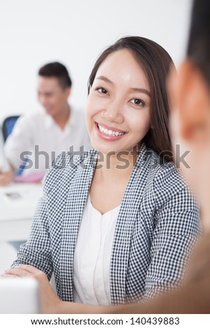 Vertical portrait of a business woman looking at camera