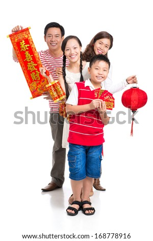 Vertical portrait of a cheerful family with red Tet symbolic isolated on white
