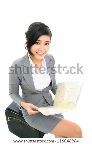 Vertical portrait of a lovely business girl studying the map - stock photo