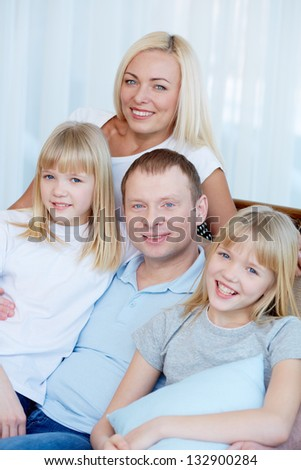 Vertical portrait of a loving family being at home together - stock photo