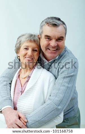 Vertical portrait of a loving senior couple - stock photo