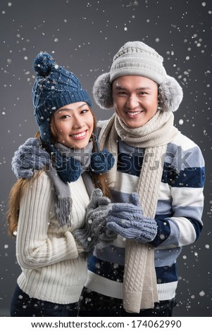 Vertical portrait of a winter romantic couple in love  - stock photo