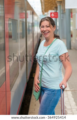 Vertical portrait of a woman waiting for her to send the train