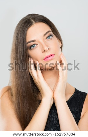 Vertical portrait of a young lovely woman posing at camera - stock photo