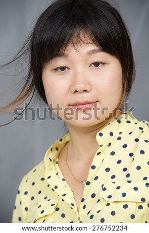 Vertical portrait of beauty Asian happy girl. Vertical photo - stock photo
