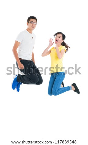 Vertical portrait of excited young people jumping against white background - stock photo