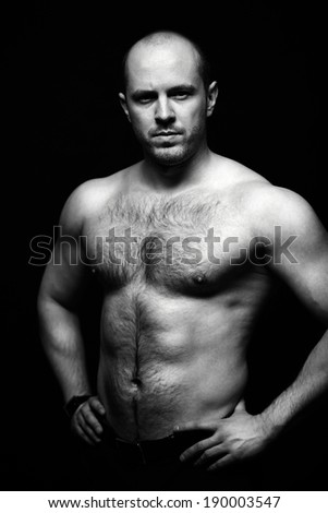 Vertical portrait of shirtless man posing for camera