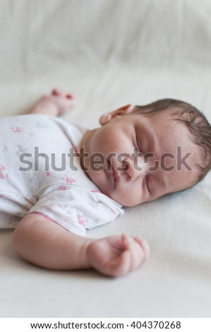 Vertical portrait of the sleeping baby - stock photo