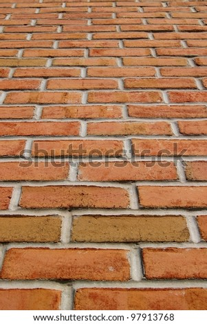 Vertical red brick wall - stock photo