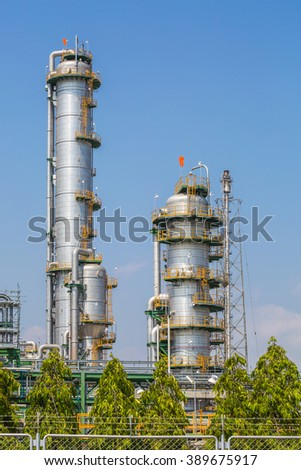 Vertical refinery tower in oil and petrochemical plant in day time