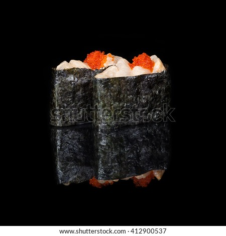 Vertical rolls with pieces of fish and flying fish roe